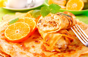 Crepes de queso, naranja y nueces